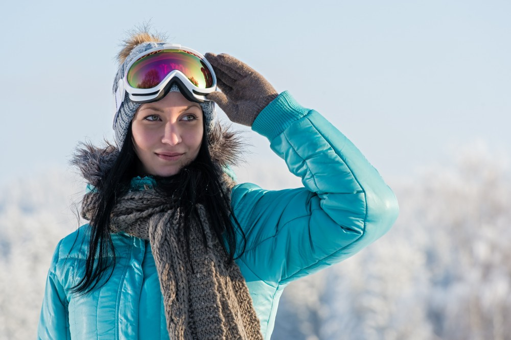 woman wearing ski goggles to protect eyes